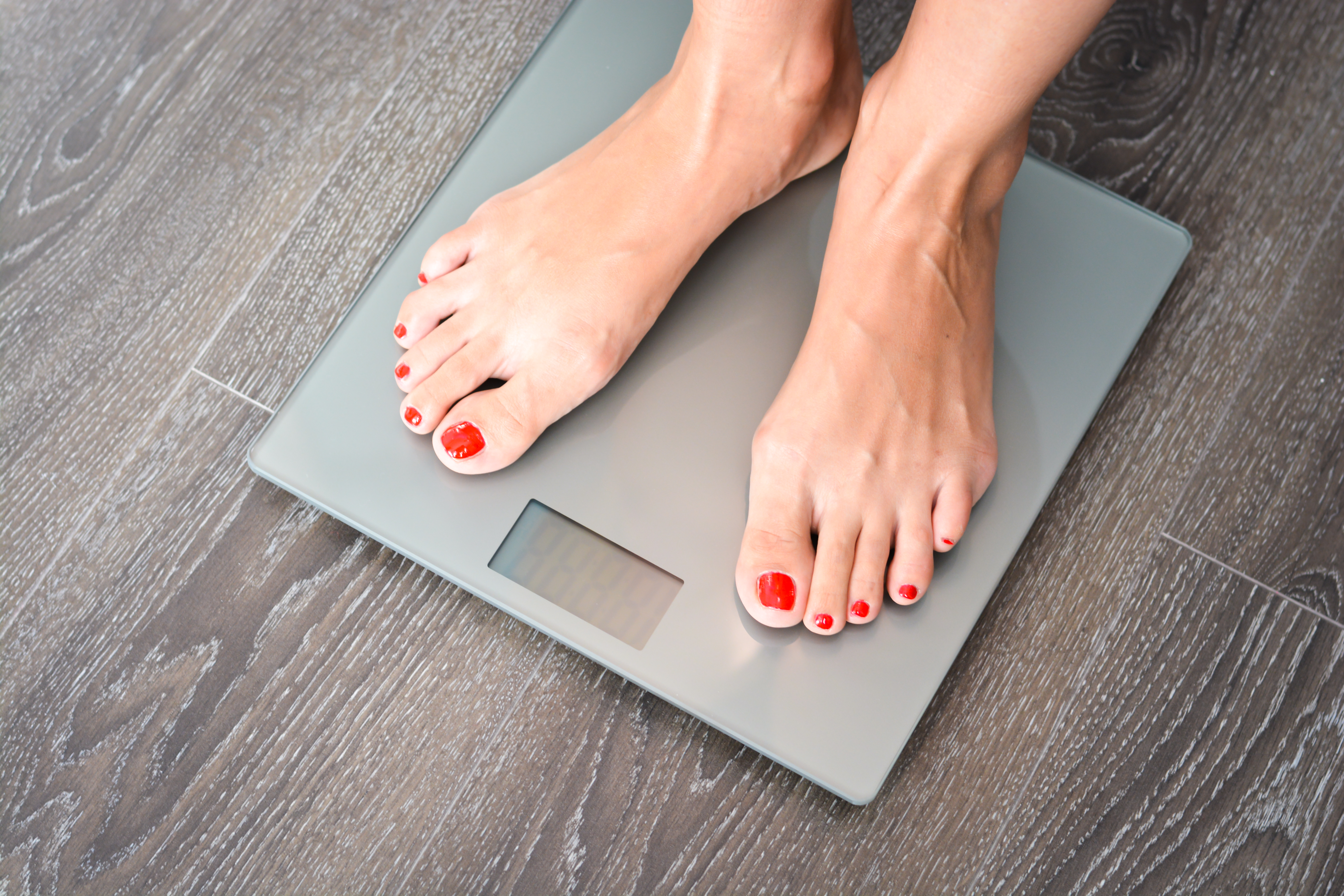 Woman's feet on weighing scales