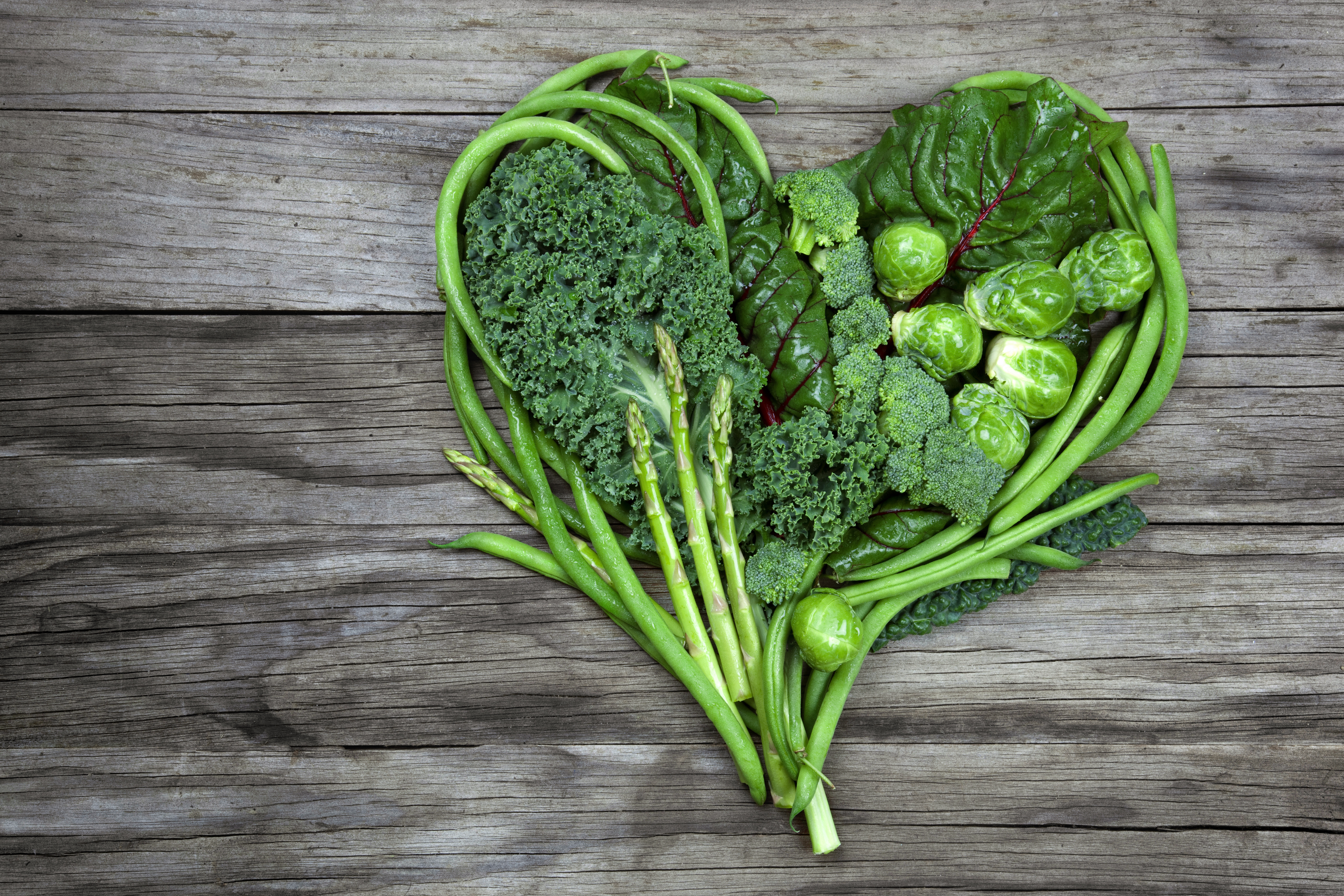 Broccoli, green beans, sprouts and asparagus in the shape of a heart