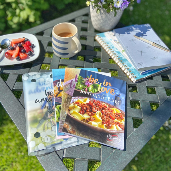 Food Optimising books, notepad, tea and fruit plate outside-making time for you-slimming world blog