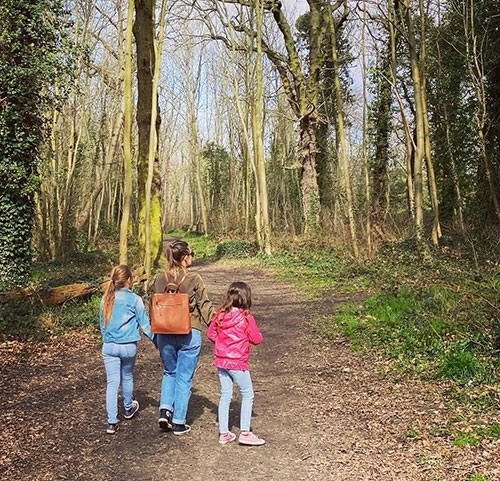 Slimming World member walking in woods with children
