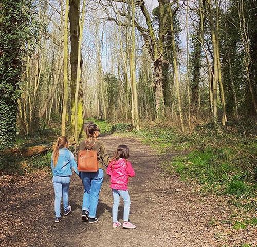 Slimming World member walking in woods with children
