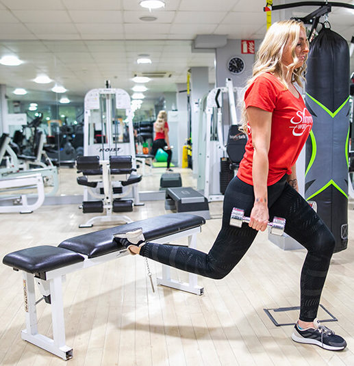 woman using weight bench