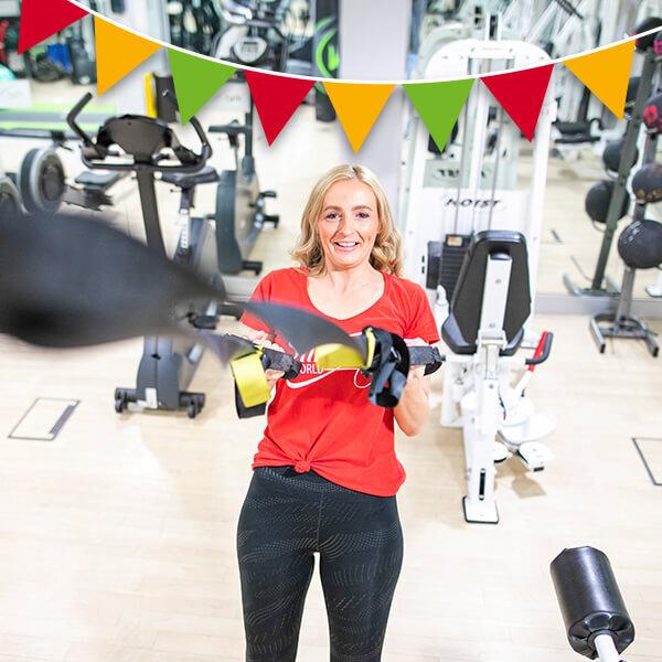 woman on TRX machine-Slimming World gym guide