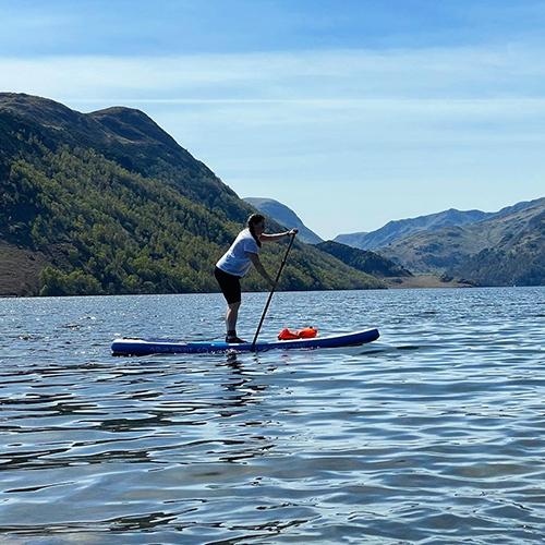 Slimming World member paddleboarding