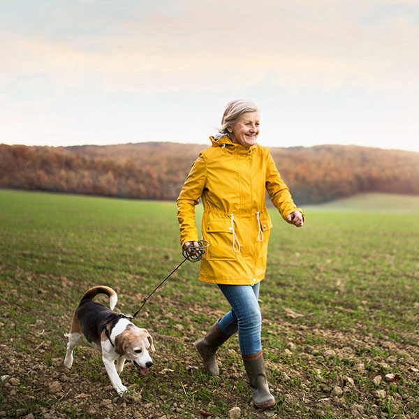 Woman running with dog-4 ways to reduce dementia risk-slimming world blog