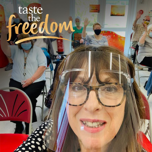 Slimming World group - lady wearing visor for safety