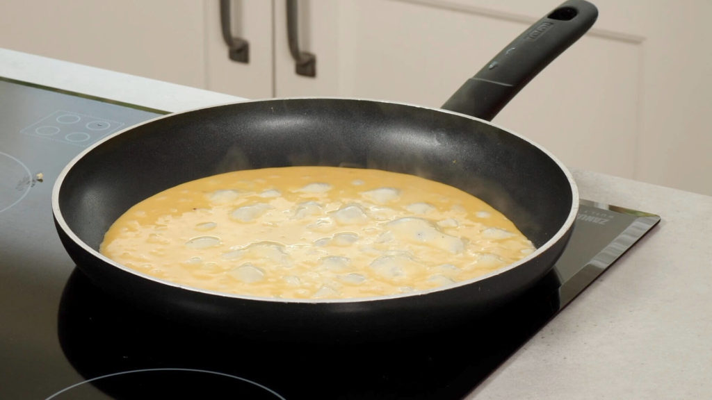 omelette cooking in frying pan-tortilla-style-wrap-slimming world blog
