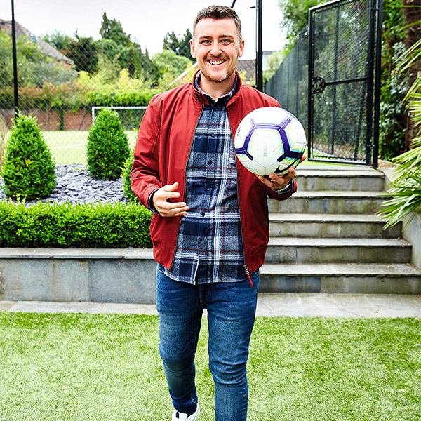 Aaron Snares walking holding football-16st weight loss-slimming world blog