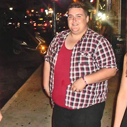 Aaron standing on street before 16st weight loss-slimming world blog