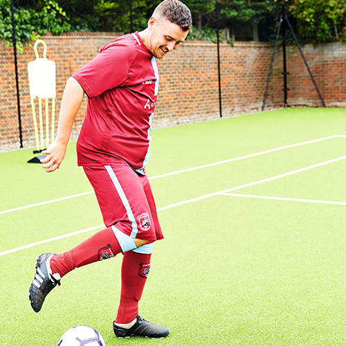 Aaron running with football-16st weight loss-slimming world blog