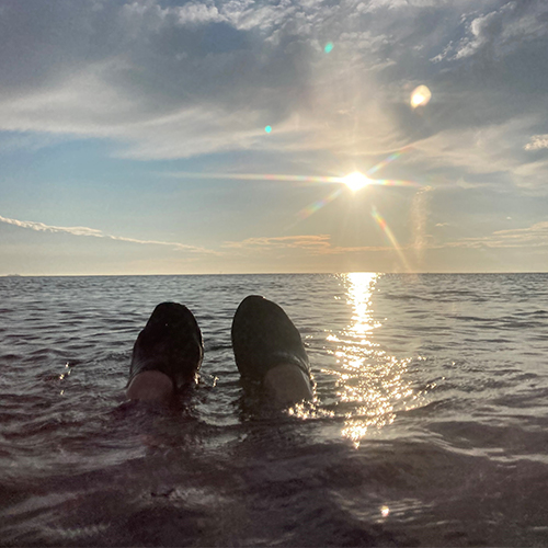 Emily's feet sticking out of sea-summer activity ideas-slimming world blog