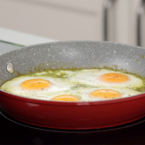Pesto fried eggs in a pan