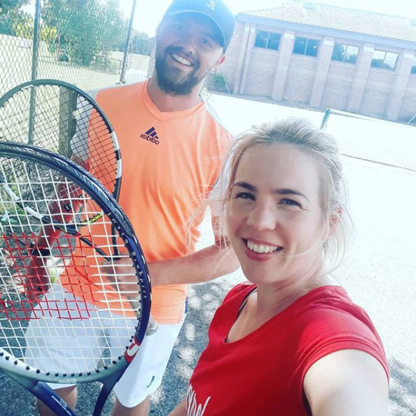 Judit holding a tennis racket-tennis tips-slimming world blog