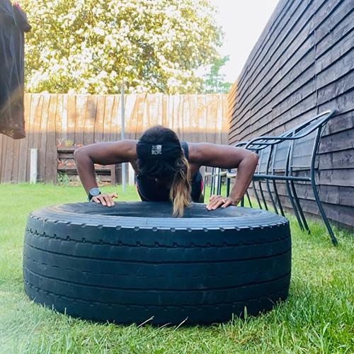 Samantha doing push-ups on a tyre-summer activity ideas-slimming world blog