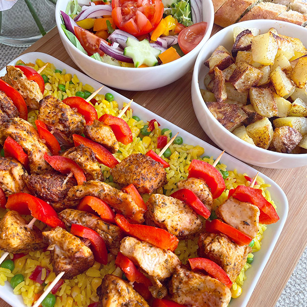 Spicy chicken kebabs with savoury rice