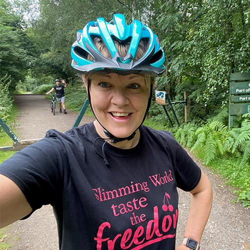 Woman wearing bike helmet-slimming world's summer of love challenge