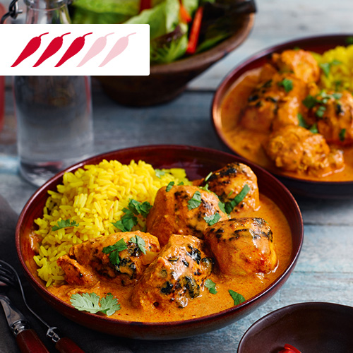 Chicken tikka masala with pilau rice in brown bowl-slimming world curry recipes