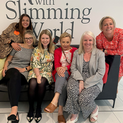 Slimming World Consultants on a sofa at head office